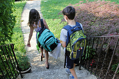 Kids wearing heavy backpacks on one shoulder will end up with aches and pains